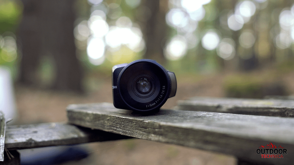 Sionyx Aurora Lens sitting on wood planks