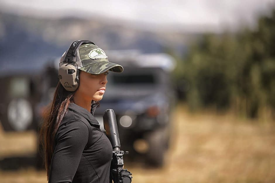 Attractive Woman with Walkers Headset and AR15